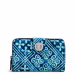 Carry-on Essentials via smelltheroses.com (Vera Bradley Wallet)
