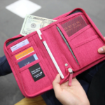 Carry-on Essentials via smelltheroses.com (Travel Wallet | MochiThings)