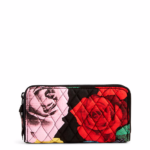 Carry-on Essentials via smelltheroses.com (Vera Bradley Georgia Wallet)